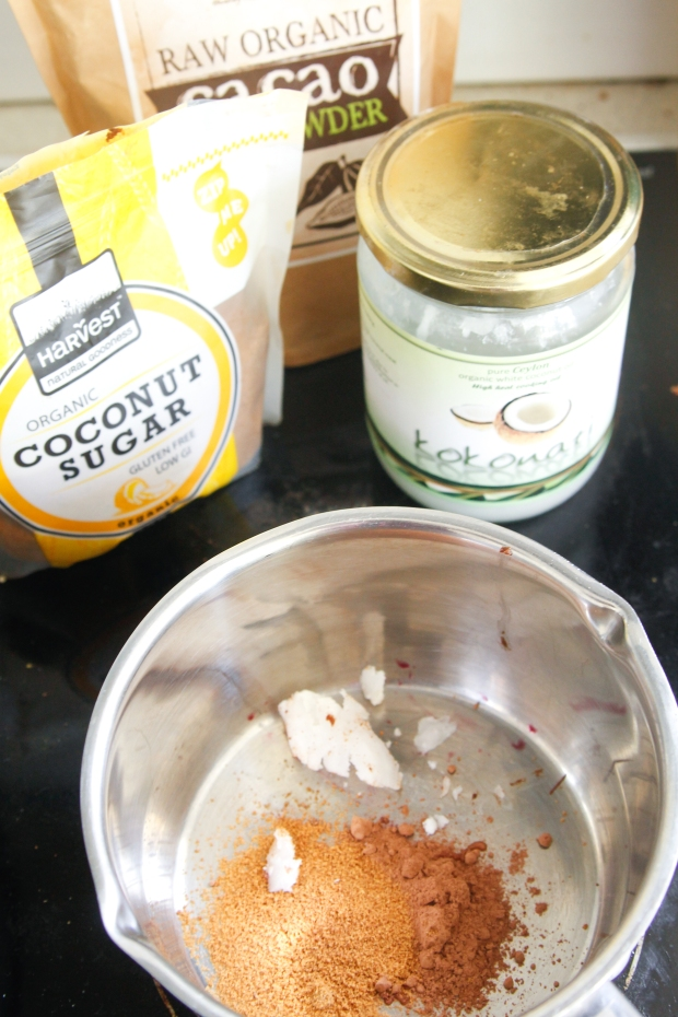 Mix together a bit of cacao, coconut sugar, coconut oil and water with a dash of vanilla in a pan on a low heat until slightly thick and gooey – taste test as you go to get the right balance of ingredients ;)